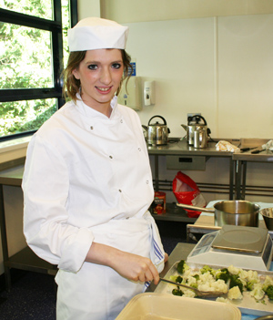 Paralympic gold medal swimmer Bethany Firth pictured at work in SERC in her catering course.