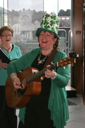 Folksinger Laura Plummer with the Lecale Singers during St Patrick's Day in the St Patrick Centre.