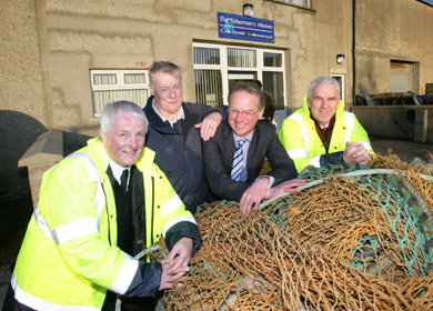 Maurice Lake, Fishermen's Mission area superintendent, Robert Cambell, caretaker and local advisory committee, Ian Nelson, Progressive Building Society, and Andrew Wright, Mission Chaplain and Director of Operations pictured outside the Kilkeel FM centre.