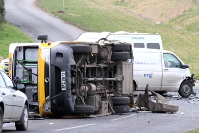 The overturned Knockevin School bus with the white van behind which were involved in a collision on the Vianstown Road.