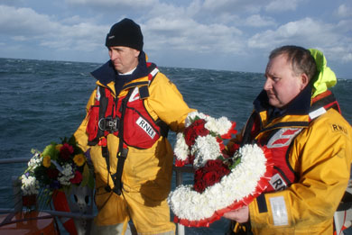 Newcastle RNLI lifeboat coxwain Mark Poland, left, with Donaghadee coxwain Philip Macnamara lay a wreath on the site of the Princess Victoria disaster.