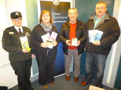 Constable Karen Thomas, Newcastle Neighbourhood Policing Team, Nuala McElroy, MARA Project Co-ordinator,  Patrick and Brian Morgan , Kilcoo Neighbourhood Watch Co-ordinators.