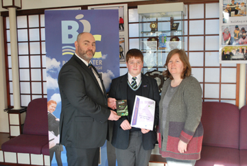 Blackwater Integrated College student Alastair Campbell is congratulated by Acting Principal Alan Hutchinson and teacher Allyson Cockfield.