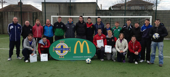 Caption: Down District Councils Chair of Recreation & Community Services Cllr Stephen Burns Congratulates the districts twenty new football coaches, as they receive their accreditation from Grassroots Development Officer Seamus Heath