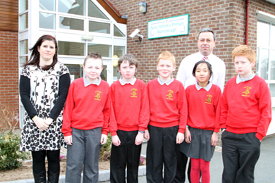 St Patrick's Primary School pupils ar Burrenragh near Castlewellan, pictured with their Principal James Hunt and Classroom Assistant Siobhan Rice are supported by the wider community to oppose any proposals to close their school.