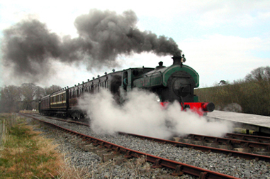 Harvey the steam engine pulls out of Inch Abbey railway station. Enjoy a trip on a train from Downpatrick.
