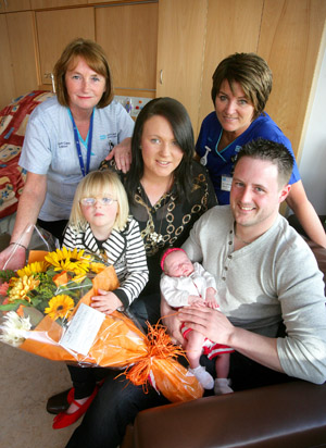 Pictured with Tanya and baby Sophie is daughter Chloe, partner Matthew, Midwife Assunta Morgan and Health Care AssistantElaine Morgan.