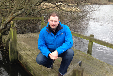 South Down MLA Chris Hazzard looks over a fishing platform on the River Quoile.