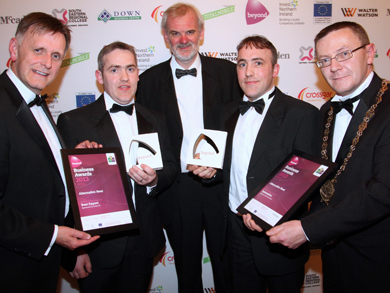 David Bleakney, Southern Area manager for Invest NI, presents the award for Best Export, to Connel and Donal McMullan of Alternative Heat.