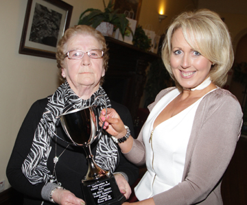 Show Chairwoman Michele McAuley receives the Roxy Trophy from Teresa Mallon for the Overall Champion for the Dogshow