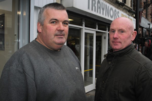 Publican Bartley Murphy talks to local businessman Damian Bell about the early morning flood in Downpatrick.