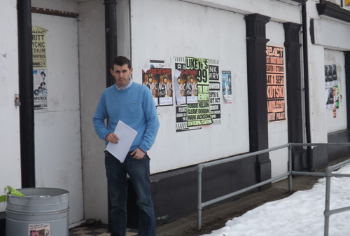 Concerned about flyposting. Councillor Stephen Burns outside the vacant Co-op building in Castlewellan.