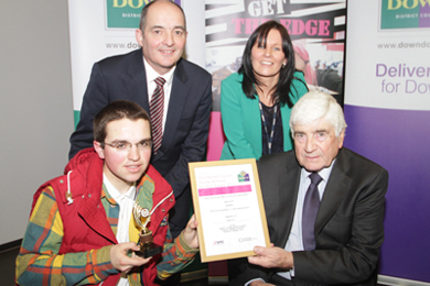Most Enterprising Student: Dylan Kelly receives his award from Councillor Dermot Curran. Included are Olivia Kennedy, SERC Enterprise and Entrepreneurship Manager, and Richard Armstong, SEELB.