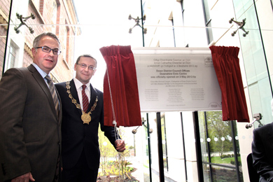Environment Minister Alex Attwood and Down Council Chairman Mickey Coogan unveil the plaque at the offical opening of the new Downshire Civic Centre in Downpatrick.