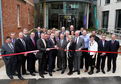 Environment Minister Alex Attwood and Down Councillor Mickey Coogan, Chairman of Down District Council, ct the ribbon to open the Down Vivic Centre. Includded are MP's Maragaret Ritchie (SouthDown and Jim Shannon (Strangford) and South Down MLA's and councillors from Down District.