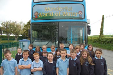 Pupils from St PAtrick's PS Legamaddy beside the NI Water waterbus.