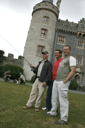 Derrygonnelly Fly fishing instructor Jim Hoy demonstrates his skills to Paul McCardle and Gary McCarthy.