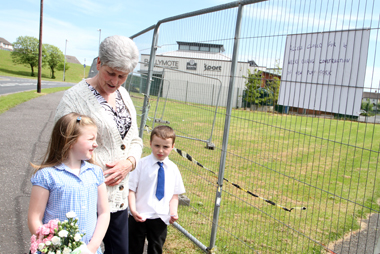 Jean Jenner from Downpatrick explains to her grandchildren Lauren and Ryan Polley about the new playpark to be build adjacent to the Ballymote Sports and Wellbeing Centre.