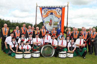 The Ballygowan Pipe Band with LOL 1207 in Ballynahinch in 2012.
