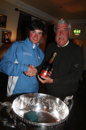 Cormac Sharvin is welcomed back to Ardglass Golf Club by former club captain Sean Murphy.