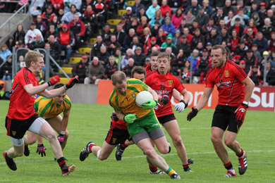 Down defenders tried to step up to the mark against a fearsome Donegal front line.