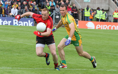 Down's Benny Coulter makes a charge for Down against Donegal's Neil McGee.