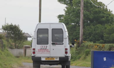 A small van takes up much of the road at Greencastle.