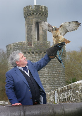 Game fair Director Albert Titterington with one of his feathered friends.