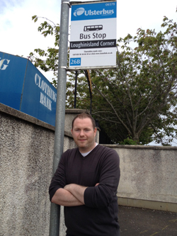 South Down MLA Chris Hazzard delighted at a bus shelter being installed in Loughinisland.