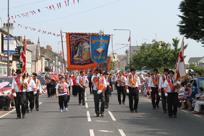 The Saintfield District banner leads their lodges in Dundrum.