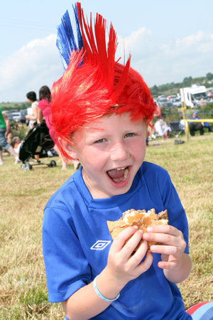 Ethan McVeigh (6) from Derryboye enjoying his beefburger after the Twelfth march ended at the the Field in Dundrum.