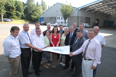 Councillors and offiicials from Down District Council join Council Chairman Councillor Maria McCarthy and representatives of Saintfield Development Assocation to celebrate the buying of premises for the new community centre.