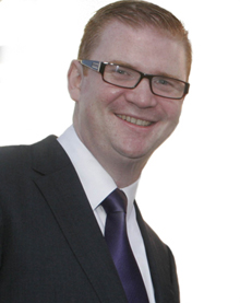 Finance Minister Simon Hamilton MLA