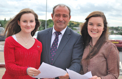 Assumption Grammar School Principal Paul McBride with top performers Niamh McKeating and Angela McCauley with 2 A* and 2 A's at A-Level.