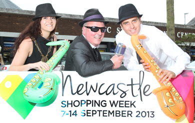 Come along and enjoy shopping week in Newcastle. launching the Council initiative are Council Chairman Cllr Marie McCarthy, local entertainer Finbarr Keaveney and Michael Forster, Council Business Support Officer.
