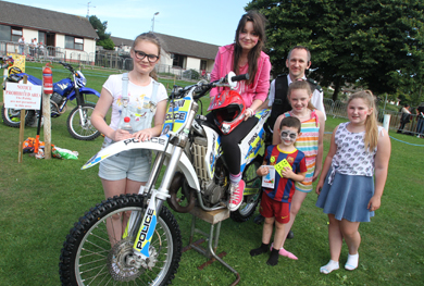 Downpatrick Neighbourhood constable Phil Quinn pictured during the fun day with some young children from the Ballymote area interested in scramblers.