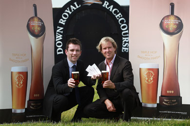 Paul McGurk (left), Innovation Marketing Manager with Tennent's NI, raises a glass of Caledonia Smooth with Mike Todd from Down Royal Racecourse, to toast the success to date of the summer ticket promotion that is running inmany pubs and clubs across Northern Ireland.