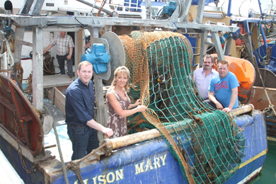 Aboard the prawn boat, the Alison Mary in Ardglass, checking out the single net trawl, are South Down MLA Chris hazzard, Martina Anderson MEP, Councillor Liam Johnston and skipper Martin Rice.