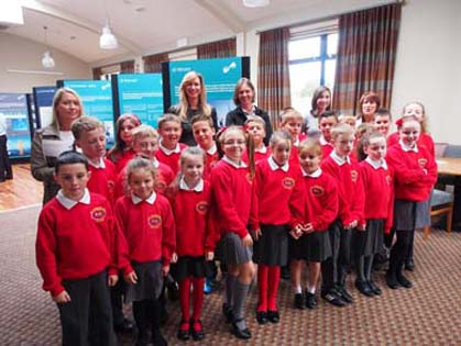 Staff and pupils from St Joseph's Primary School in Killough met Victoria McCabe and Sacha Workman from First Flight Wind at the Information Day held at the Ardglass Golf Club