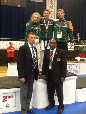 Mairead Kavanagh, Rory Kavanagh and Declan Kavanagh, (Coach). Front Row:  Sensei Jon Wicks 8th Dan (WIKF World Chief Instructor), William Millesrson 8th Dan (WKF Vice Chairman and President World WIKF)