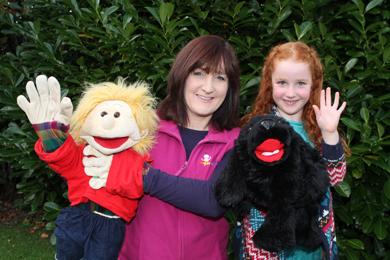 Deirdre McLaughlin of Sign2Music with her daughter Cara clebrate with a little help from Signing Sandy and Daisy Dog.