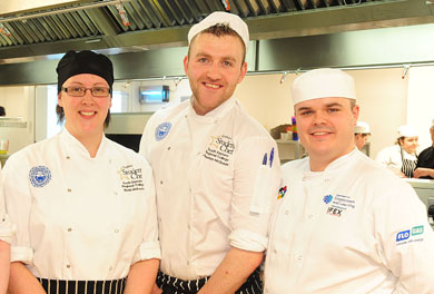 SERC Professional Cookery students Roisin McKeown and Jonathan McQuade, celebrating with tutor Michael Gillies, after they successfully achieved an impressive 5 Distinctions in their diploma and secured full-time employment with Lisbarnett House Comber.