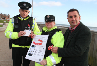 Newcastle Neighbourhood Police Sergeant Jimmy McIlveen, Constable Karen and Councillor Willlie Clarke, PCSP Chairman, launch the ICE initiative.