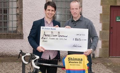 Peadar Curran, right, presents a cheque for £865 to xx of Aware Defeat Depression.