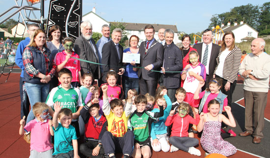 Down District Councillor Gareth Sharvin, Council Vice Chairperson,  officially opens up Annsborough playpark with DARD Permanent Secretary Noel Lavery.