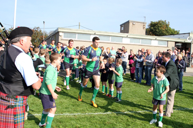 Hinch captain Andrew Morrow leads his team on to the field against Cork Con.