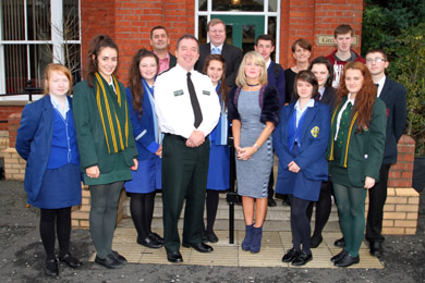 Chief Constable Matt Baggot pictured with pupils from locval secondary schools, and members of the Down PCSP and NI Policing Board just before their mini-cinference on communityd safety at the Great Hall in the Downshire Estate in Downpatrick.