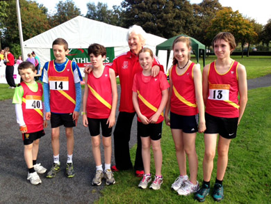 L to R Michael and Christopher O'Connor, Daniel Atkinson, Edie and Ella Carroll and Owen Edwards with Dame Mary Peters at Victoria park on Saturday.