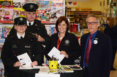At teh advice session in Newcastle Tesco were Constable Karen Thomas, Sergeant James McIlveen, Dolores Coulter, and Brian Mulligan, (Tesco customer assistant..