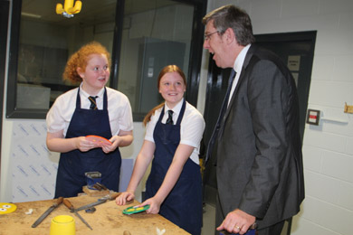 Minister John O'Dowd chats to Shimna Integrated College pupils Teigh McKee and Tanya Mullins in the Technology and Design Suite.
